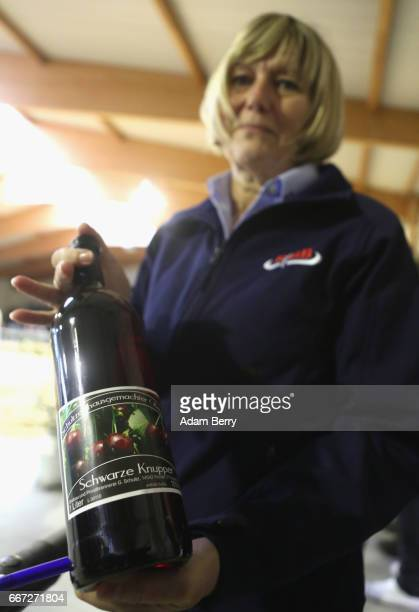 An official shows a bottle of local cherry wine provided to farmers agreeing to purchase a heifer for at least 2500 euros the minimum amount required...