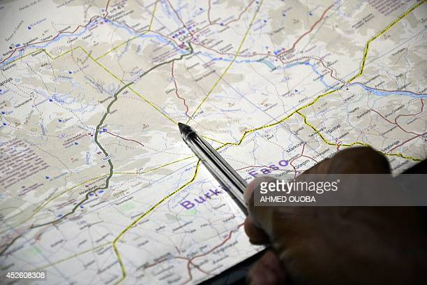 An official shows on a map an area where an Air Algerie plane is supposed to went missing on July 24 2014 in Ouagadougou An Air Algerie plane with...