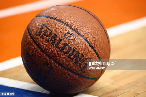 An official Spalding basketball rests on the floor during a break in game action between the Memphis Grizzlies and the New York Knicks at Madison...