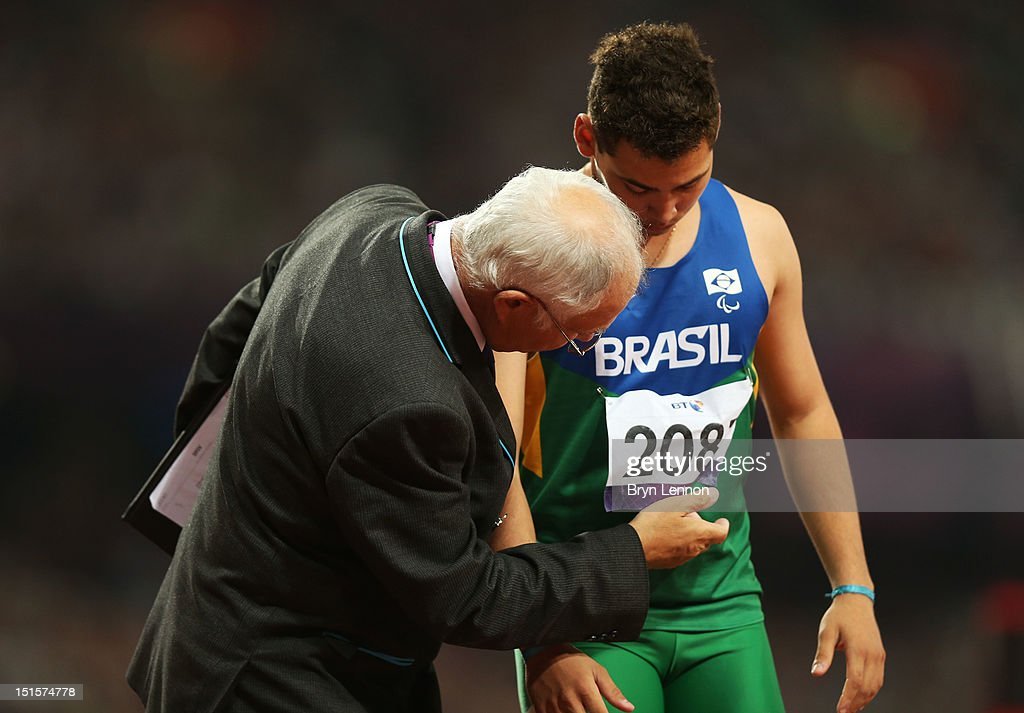 An official speaks to Alan Fonteles Cardoso Oliveira of Brazil prior to the Men's 400m T44 Final on day 10 of the London 2012 Paralympic Games at Olympic Stadium on September 8, 2012 in London, England.