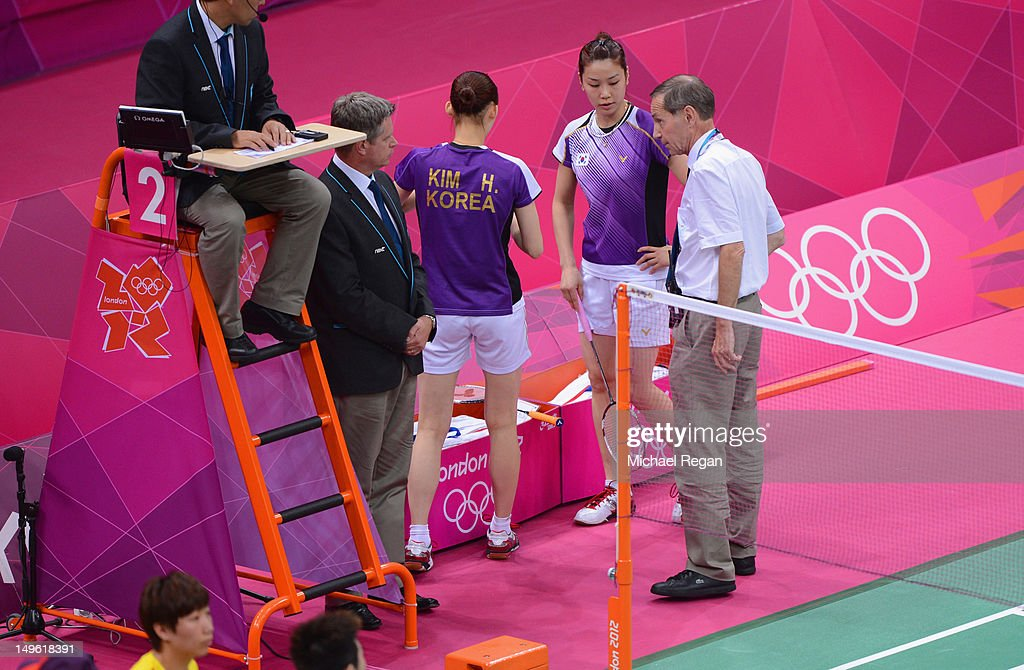 An official speaks with Jung Eun Ha and Min Jung Kim of Korea during their Women's Doubles Badminton match on Day 4 of the London 2012 Olympic Games at Wembley Arena on July 31, 2012 in London, England.