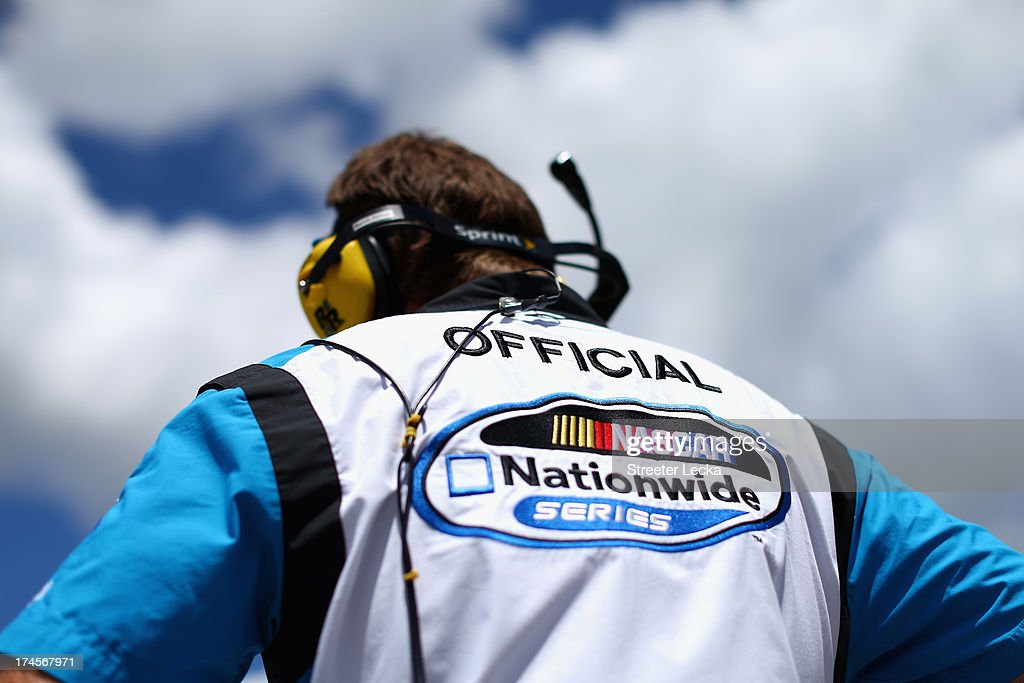 An official stands on the grid during qualifying for the NASCAR Nationwide Series Indiana 250 at Indianapolis Motor Speedway on July 27, 2013 in Indianapolis, Indiana.