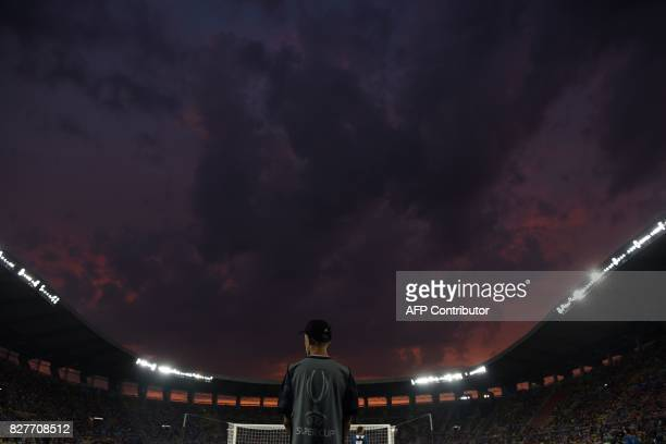 An official stands on the pitch prior to the UEFA Super Cup football match between Real Madrid and Manchester United on August 8 at the Philip II...