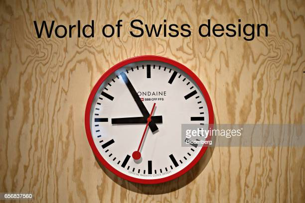 An official Swiss Railways model clock produced by Mondaine Watch Ltd hangs on display at the company's booth during the 2017 Baselworld luxury watch...