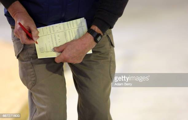 An official takes notes during an annual heifer auction on April 11 2017 in Gross Kreutz Germany Around 80 Angus Charolais Hereford Uckermärker...