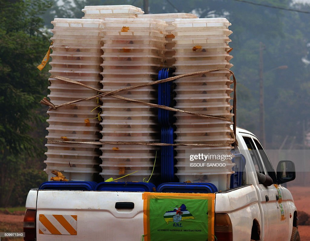 An official van of the 'Autorite National Des Election (ANE) carries ballot boxes and other voting materials on the eve of Central African Republic second round presidential and legslatives election on February 13, 2016, in Bangui. The Central African Republic holds delayed presidential and parliamentary polls on February 14, with voters desperate to usher in peace after the country's worst sectarian violence since independence in 1960. / AFP / ISSOUF SANOGO