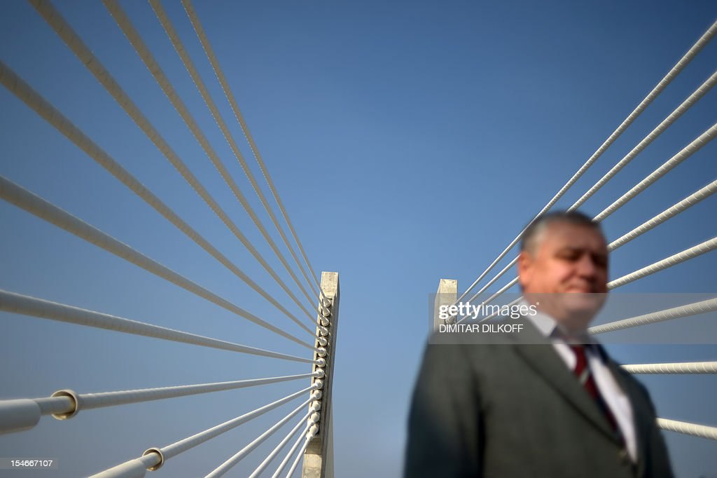 An official walks during an inspection of the construction of the Calafat-Vidin bridge on Danube river between Bulgaria and Romania on October 24, 2012.