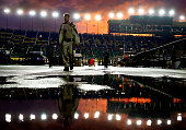 An official walks through the garage area during a rain delay of the NASCAR Sprint Cup Series SpongeBob SquarePants 400 at Kansas Speedway on May 9...