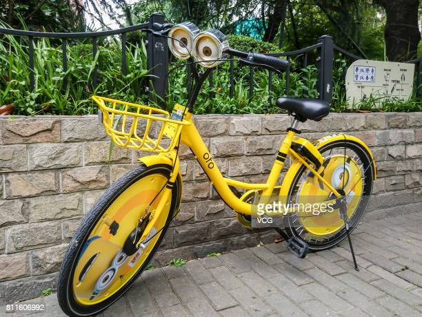 An Ofo sharing bike with the version of Minions is pictured at the Bund on July 10 2017 in Shanghai China The Ofo one of the leading bike sharing...