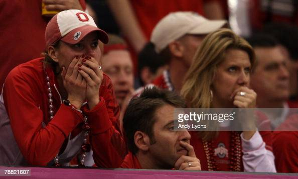 An Ohio State Buckeye fan watches as the clock ticks down on their 3824 loss to the Louisiana State University Tigers in the AllState BCS National...