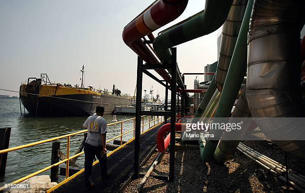 An oil barge is offloaded at Stuyvesant Fuel Service a 22million gallon capacity deepwater oil terminal June 10 2008 in the Bronx borough of New York...