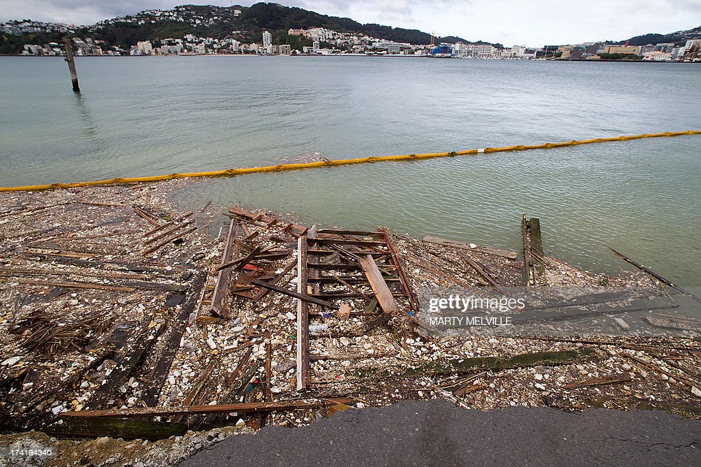 An oil boom is used to hold in debris from where the land fell into the sea at the Port Wellington Container terminal caused by yesterdays earthquake on July 22, 2013. Wellington was hilt by a 6.5 magnitude earthquake on Sunday afternoon at 5.06pm on July 21 causing medium damage to the city.