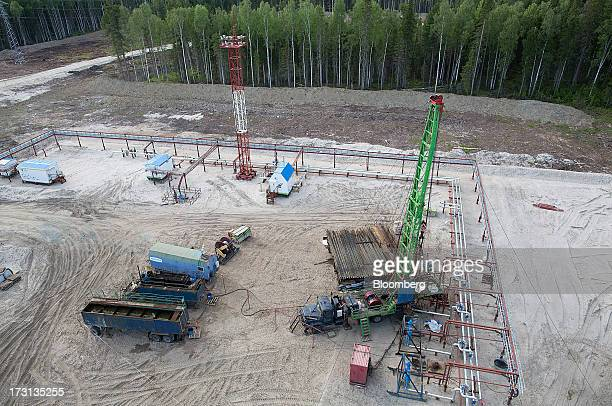 An oil derrick operated by Salym Petroleum is set up in a forest clearing in Salym KhantyMansi autonomous region Russia on Tuesday July 2 2013...