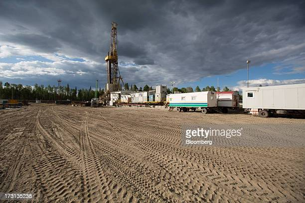 An oil derrick operated by Salym Petroleum stands in Salym KhantyMansi autonomous region Russia on Tuesday July 2 2013 Gazprom Neft and Shell have...