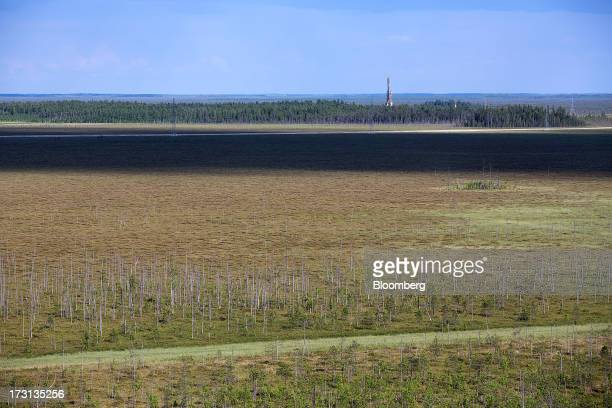 An oil derrick operated by Salym Petroleum stands near Siberian forest in Salym KhantyMansi autonomous region Russia on Tuesday July 2 2013 Gazprom...