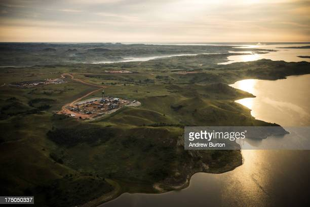 An oil drilling rig is seen in an aerial view in the early morning hours of July 30 2013 near Bismarck North Dakota The state has seen a boom in oil...
