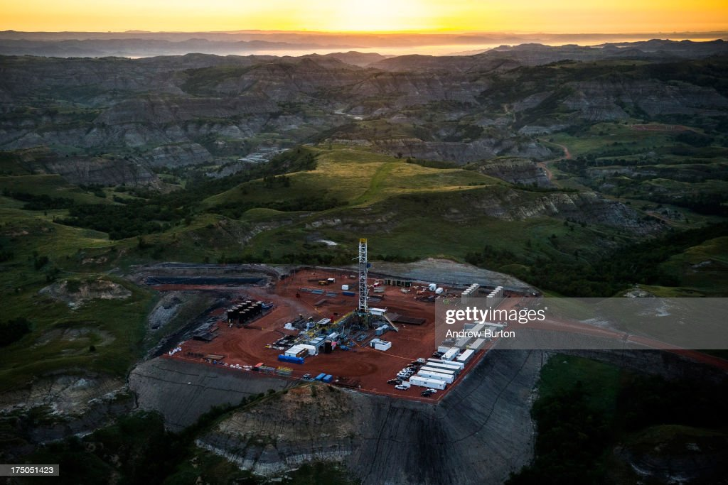 An oil drilling rig is seen in an aerial view in the early morning hours of July 30, 2013 near Watford City, North Dakota. The state has seen a boom in oil production thanks to new drilling techniques including horizontal drilling and hydraulic fracturing.