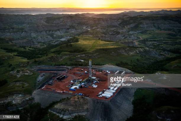 An oil drilling rig is seen in an aerial view in the early morning hours of July 30 2013 near Watford City North Dakota The state has seen a boom in...