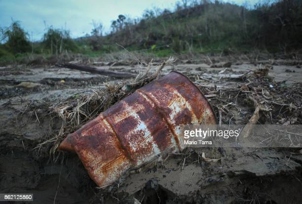 An oil drum sits amid mudslide debris nearly three weeks after Hurricane Maria hit the island on October 10 2017 in Utuado Puerto Rico Most of the...