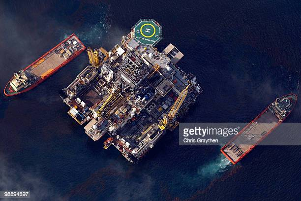 An oil platform and ships sit at the site of the Deepwater Horizon well head operated by BP on May 6 2010 in the Gulf of Mexico The well is still...