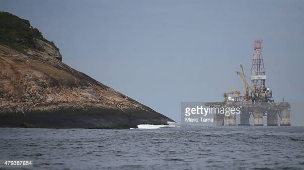 An oil platform floats in the Atlantic Ocean near Guanabara Bay on July 3 2015 in Rio de Janeiro Brazil The stateowned oil company Petrobras is...