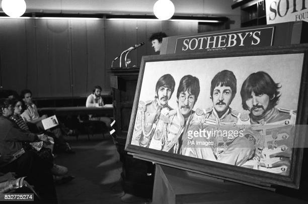 An oil portrait of the Beatles in their 'Sgt Pepper' uniforms by R Hurcombe dated 1985 which sold for 800 at the Sotheby's Rock 'n Roll memorabilia...