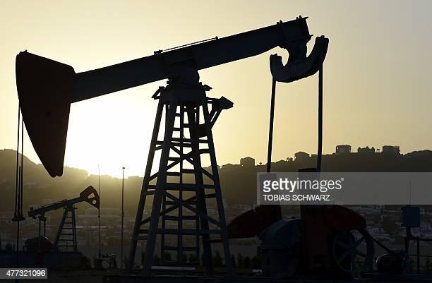 An oil pump is pictured in Baku on June 16 2015 AFP PHOTO / TOBIAS SCHWARZ