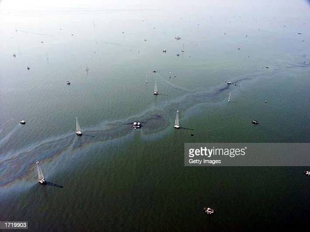 An oil slick is seen near oil rigs in the western Lake Maracaibo production areas in this undated aerial photo Striking workers charge that the oil...