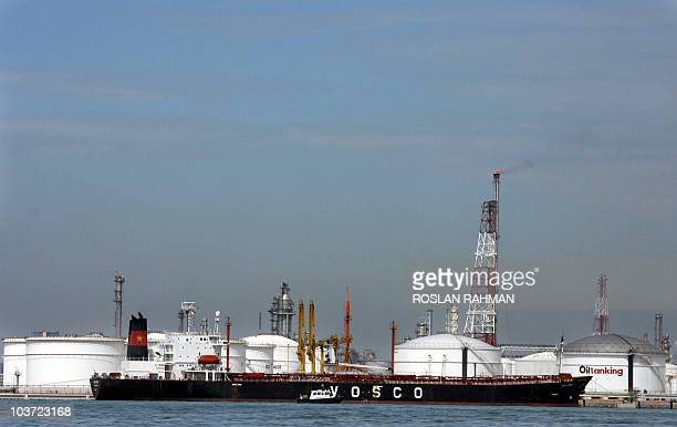 An oil tanker berth next to the oil tanking facilities on an island off Singapore 12 April 2006 Oil prices fell in Asian trading on profittaking...