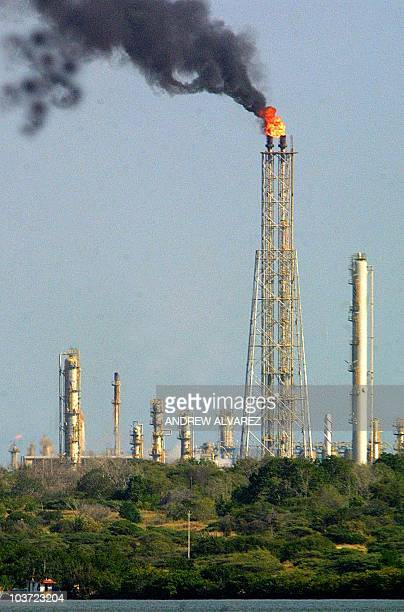An oil tower at the PDVSA oil refinery burns in the city of Maracaibo Venezuela 07 December 2002 Oil prices roared up to new record high levels...