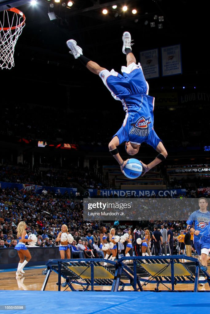 An Oklahoma City Thunder performer dunks during a game break against the Atlanta Hawks on November 4, 2012 at the Chesapeake Energy Arena in Oklahoma City, Oklahoma.