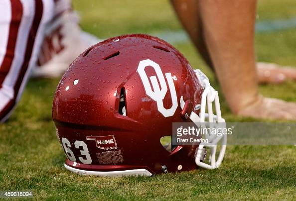An Oklahoma Sooners helmet on the field during warm ups before the game against the Kansas Jayhawks November 22 2014 at Gaylord FamilyOklahoma...