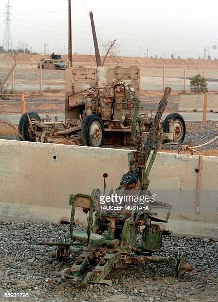 An Old 57mm antiaircraft cannon is seen inside a US camp in Tikrit 16 October 2005 Over 60 percent of the 155 million Iraqi voters cast their ballots...