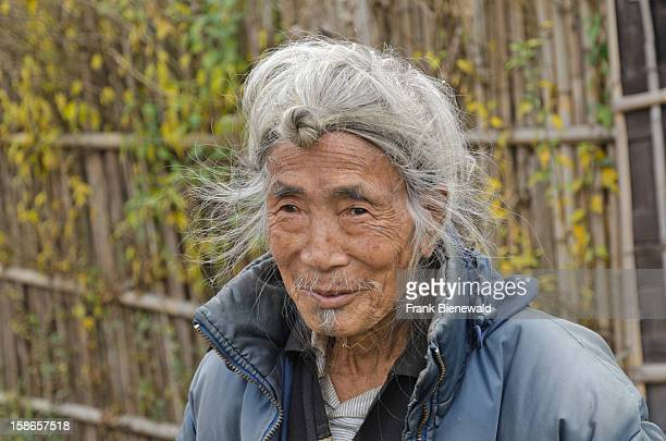 An old Apataniman wearing the traditional hairstyle with the knop at his forehead