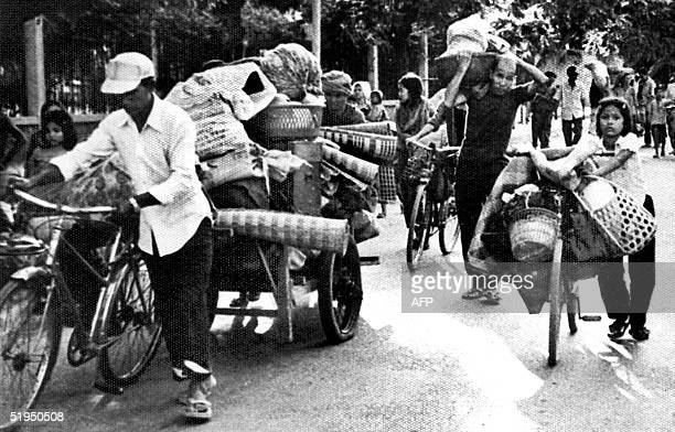 An old archive picture from Agence Khmere de Presse shows Cambodian people on the road during the exodus after Khmer Rouge forces seized Phnom Penh...