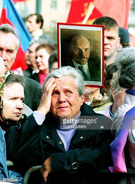 An old babushka cries 01 May 1994 as she listens to the speech of one of the leaders of the Communist Party of Russia during a May Day demonstration...
