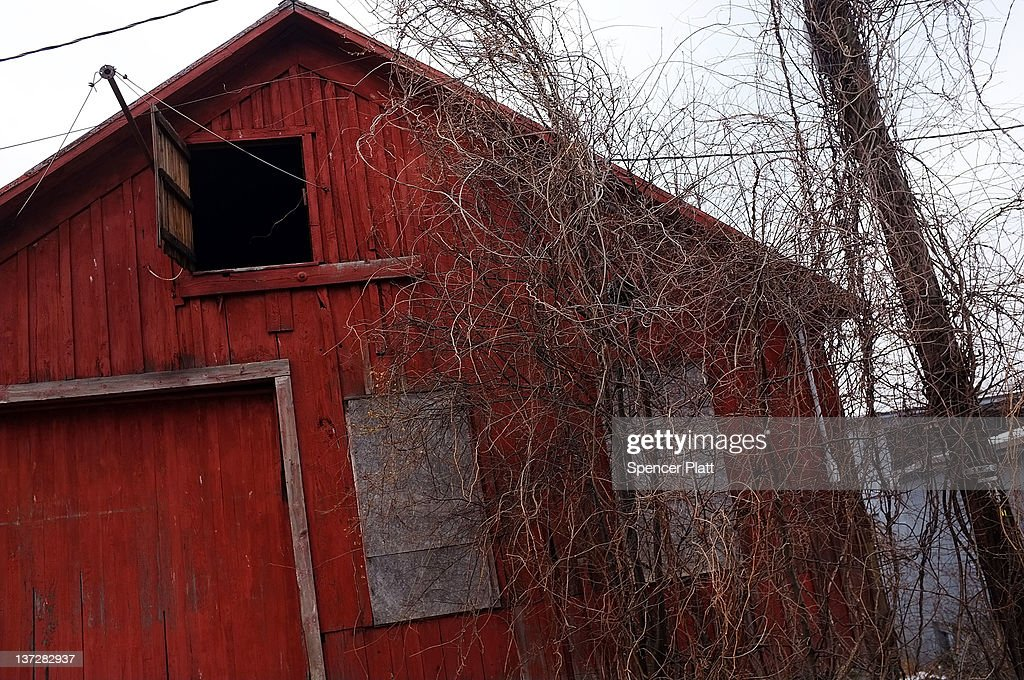 An old barn is viewed in the village of Montrose which is now at the center of the natural gas industry's search for gas on January 18, 2012 in Montrose, Pennsylvania. The once struggling area has wittnesed a boom as thousands of workmen and dozens of companies associated with the Hydraulic fracturing industry have moved to town. Hydraulic fracturing, also known as fracking, stimulates gas production by injecting wells with high volumes of chemical-laced water in order to free-up pockets of natural gas below. The process is controversial with critics saying it could poison water supplies, while the natural-gas industry says it's been used safely for decades. While New York State has yet to decide whether to allow fracking, economically struggling Binghamton has passed a drilling ban which prohibits any exploration or extraction of natural gas in the city for the next two years. The Marcellus Shale Gas Feld extends through parts of New York State, Pennsylvania, Ohio and West Virginia and could hold up to 500 trillion cubic feet of natural gas.