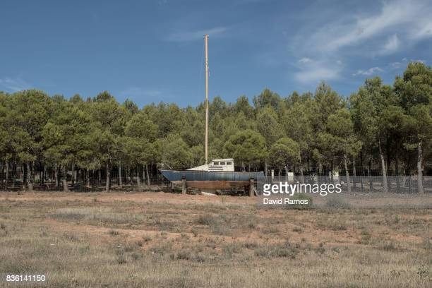 An old boat sits on the dried bed of Entrepenas reservoir second largest water reservoir feeding the Segura River and Spain's Southeastern regions...