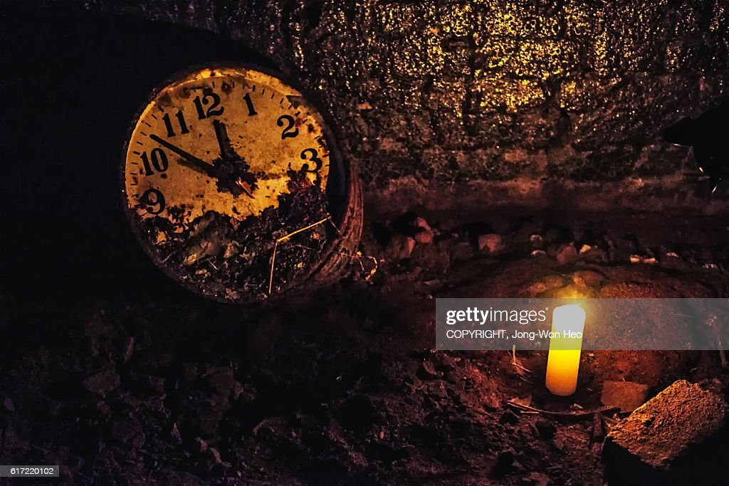 An old broken clock in the dark : Stock Photo