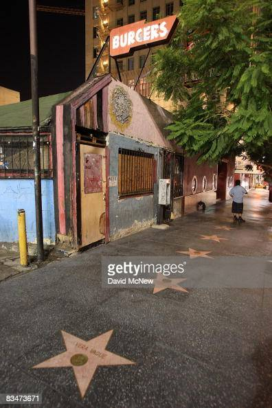 An old burger stand along the Hollywood Walk of Fame is vacant and decaying on Vine Street near the Hollywood landmark intersection of Hollywood and...
