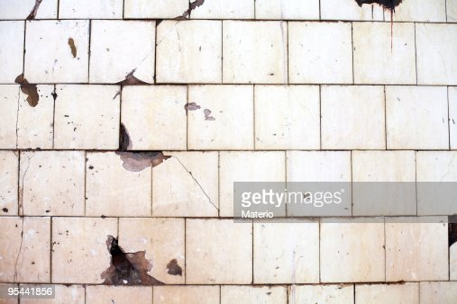 An Old Chipped Offwhite Tile Wall Stock Photo Getty Images