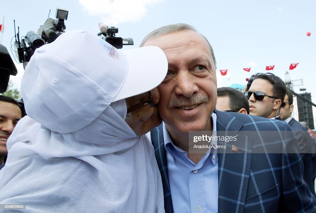 An old citizen and Turkish President Recep Tayyip Erdogan (R) are seen during an opening ceremony in Diyarbakir, Turkey on May 28, 2016.