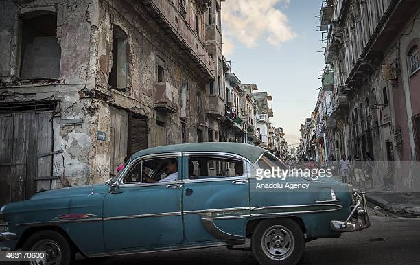 An old classic car on which there is an 'Apple' logo one of the leading brands of America is seen at a street of Havana capital city of Cuba on...