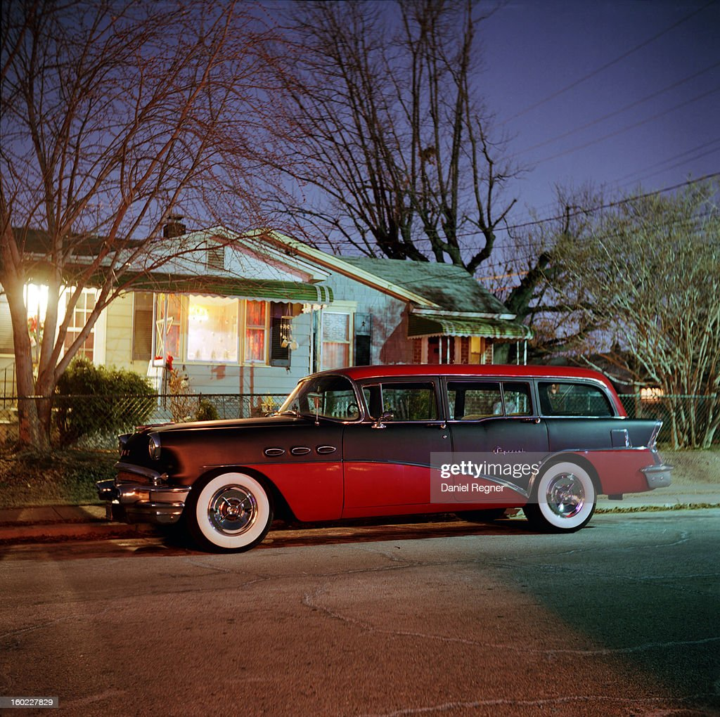 CONTENT] An old classic red station wagon can be seen parked outside of a typical suburban home on a nice clear evening.