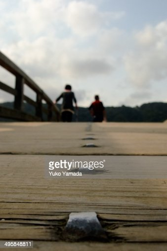 An old couple crossing Kintaikyo Bridge