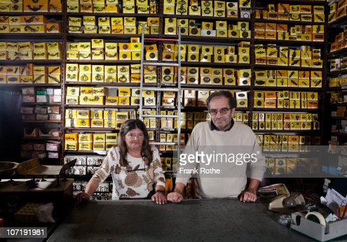 an old couple running there shop together  : Stock Photo