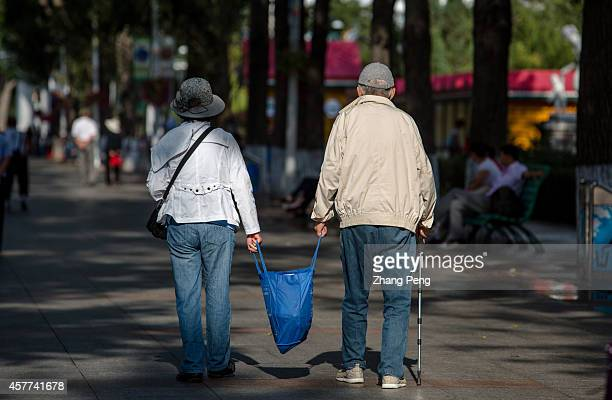 HA'ERBIN HEILONGJIANG CHINA An old couple take handbag together walking on the street In China there are more than 200 million old people of over 60...