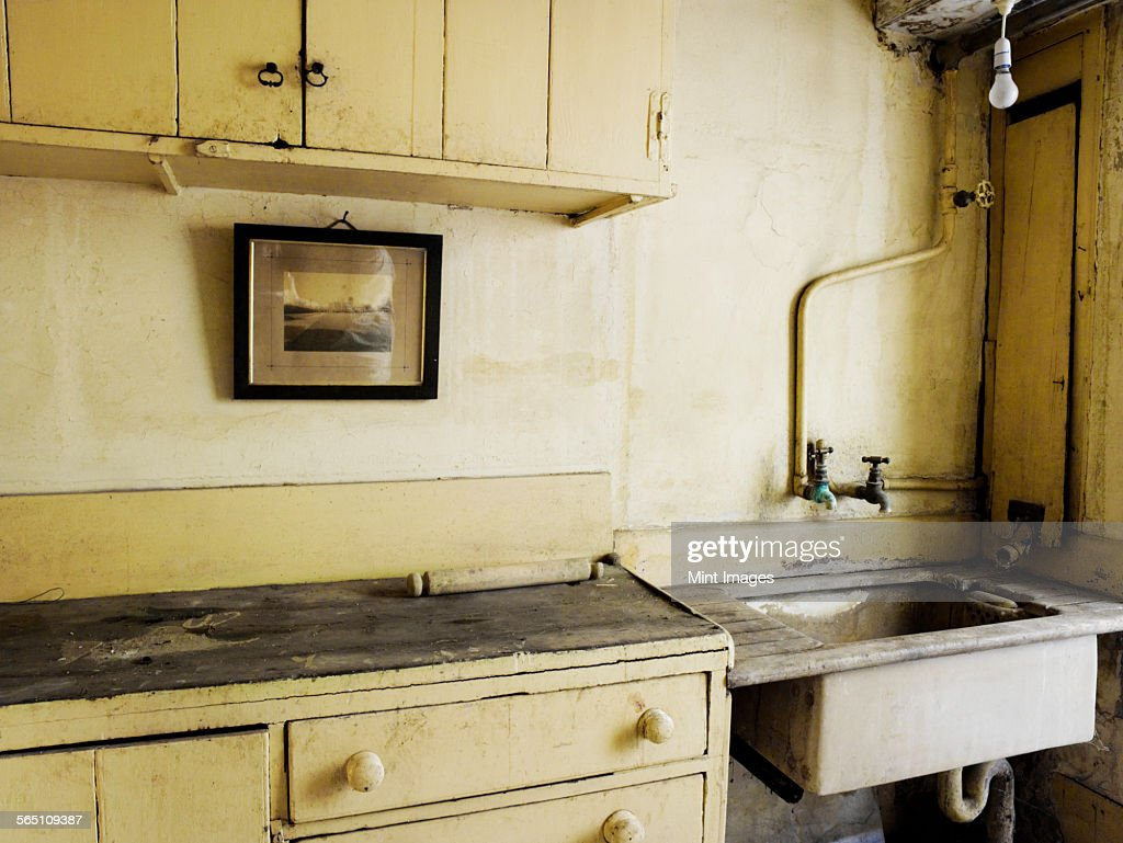 An Old Fashioned Kitchen Sink And Cupboards. : Stock Photo