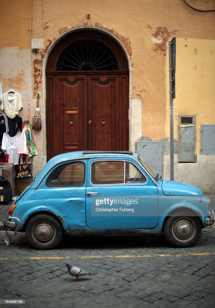 An old Fiat car sits in a side street on March 29, 2013, in Rome, Italy.