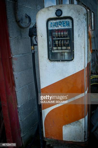 An old gas pump is seen in front of a farm on March 18 2015 near Niort eastern France Thirty years after introducing quotas to combat the butter...